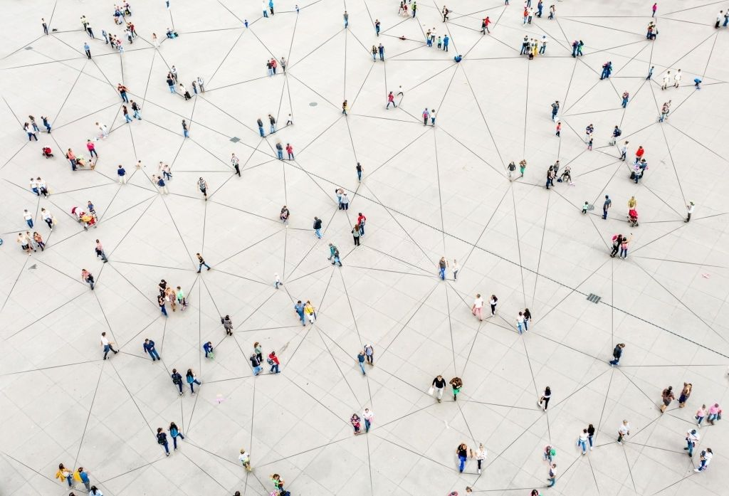 Aerial view of people connected by a network of lines
